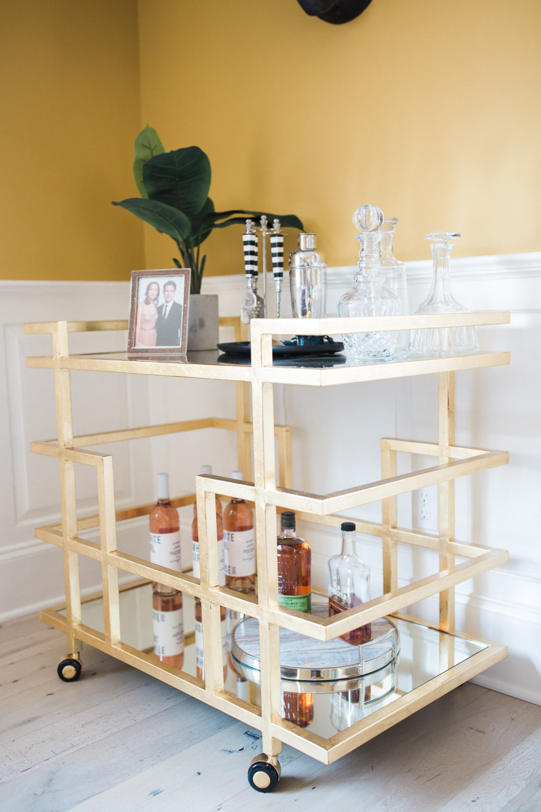 A deco gold bar cart in the living room of Eva Amurri Martino's home in connecticut