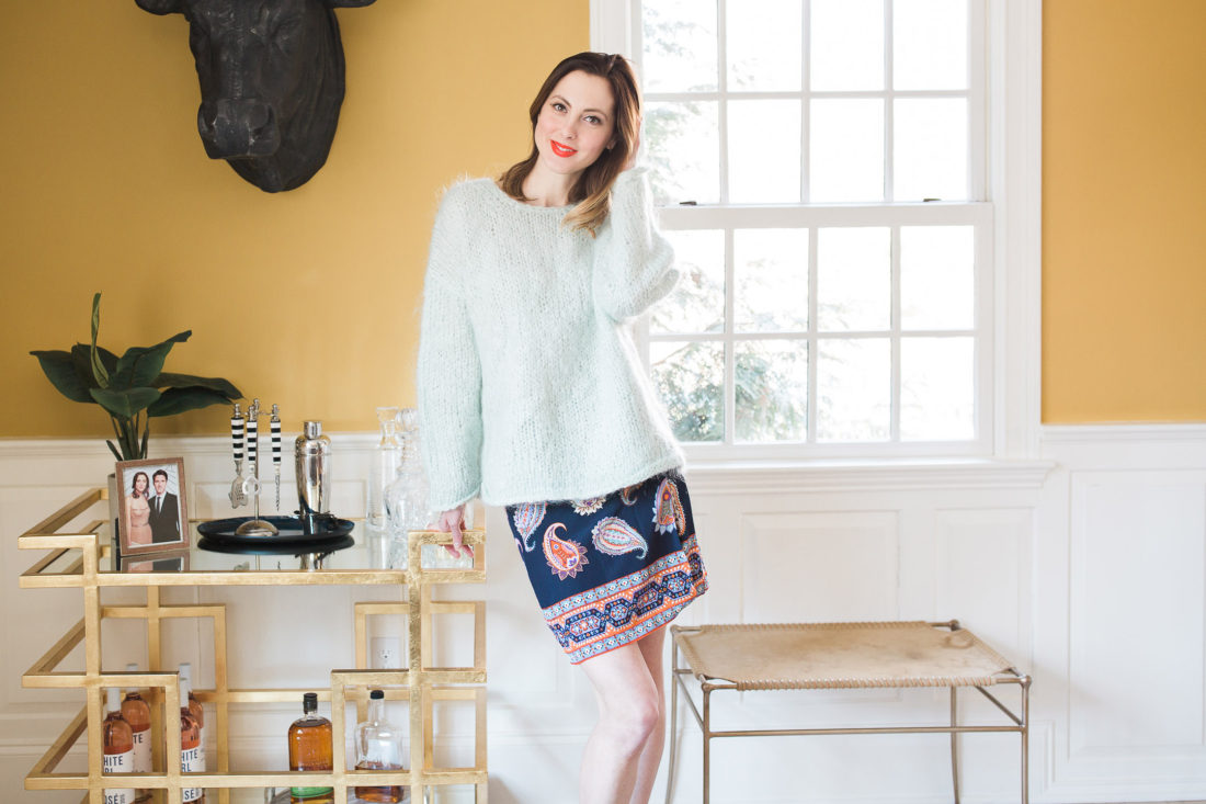 Eva Amurri Martino stands next to the gold bar cart in the living room of her Connecticut home