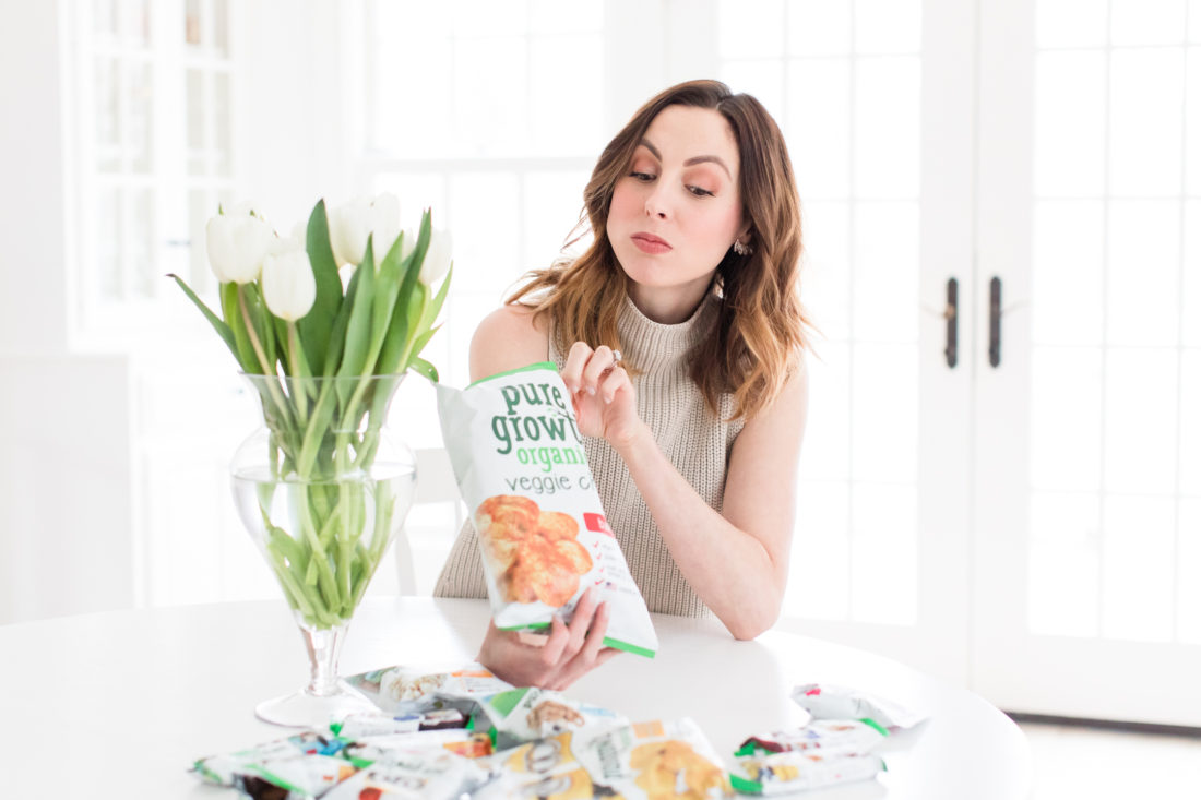Eva Amurri Martino sits at her kitchen table eating organic snacks