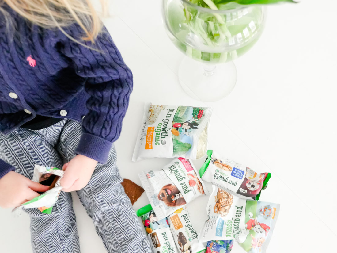 Marlowe Martino sits with a pile of snacks