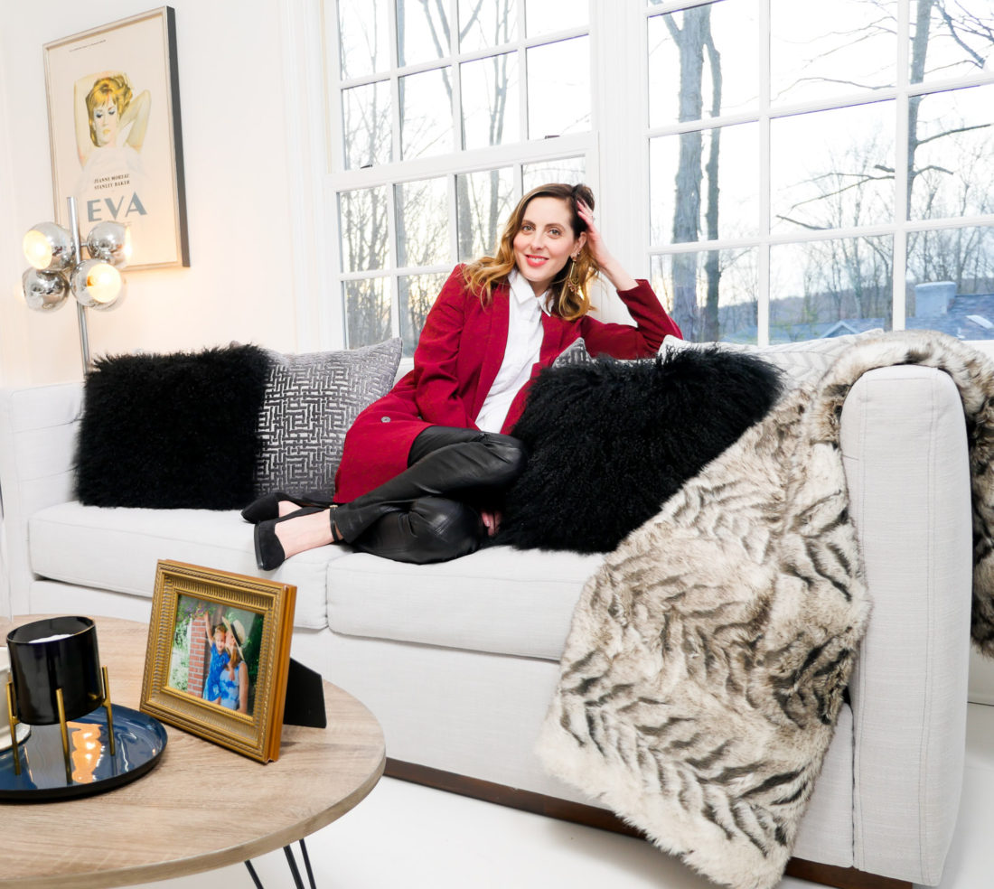 Eva Amurri Martino relaxes on her updated couch design concept featuring a bold masculine concept