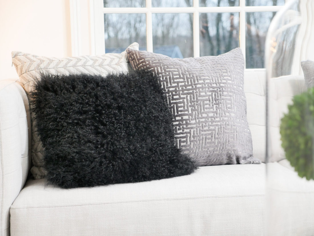 Masculine, textured pillows at weight to a simple design concept