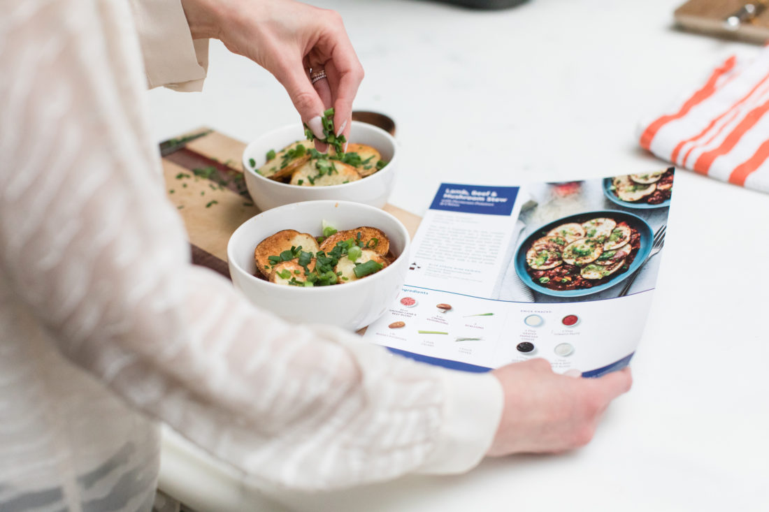 Eva Amurri Martino puts the finishing touches on her Blue Apron lamb stew