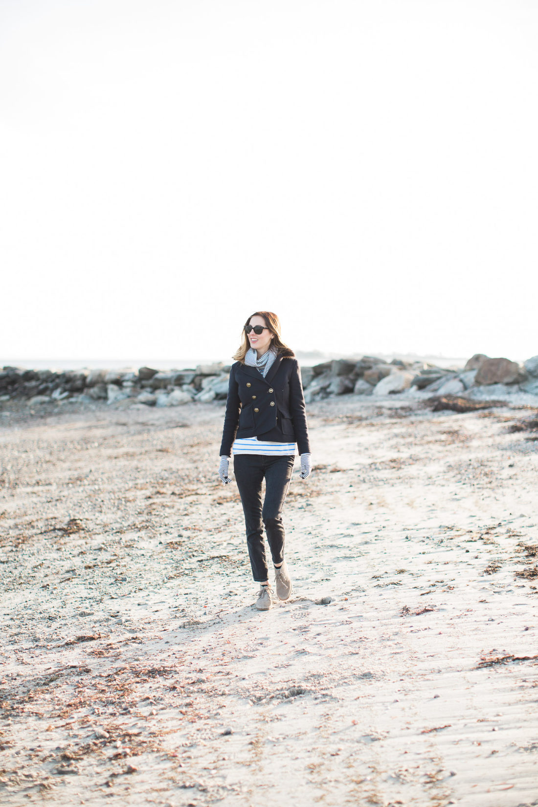 Eva Amurri Martino walks along the sand in the chilly weather at Compo Beach in Connecticut