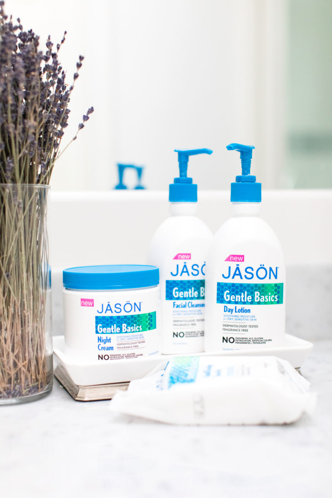 Eva Amurri Martino's selection of Jason Gentle Basics skin care is arranged on the marble countertop in her master bathroom