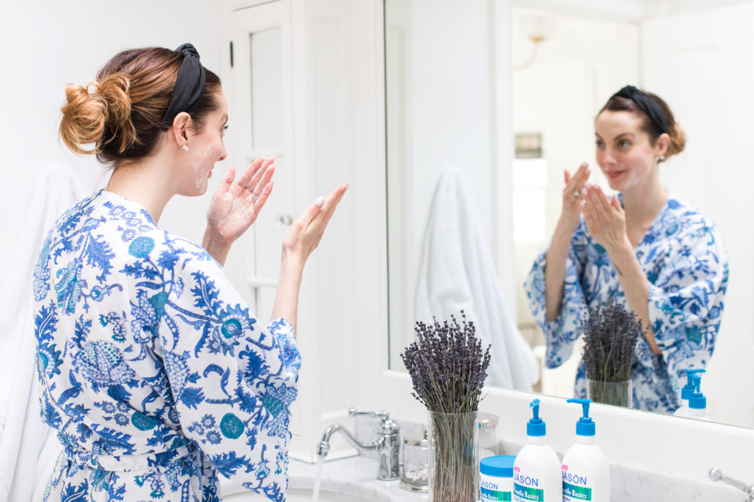 Eva Amurri Martino massages creamy facial cleanser in to her face during her night time cleansing ritual