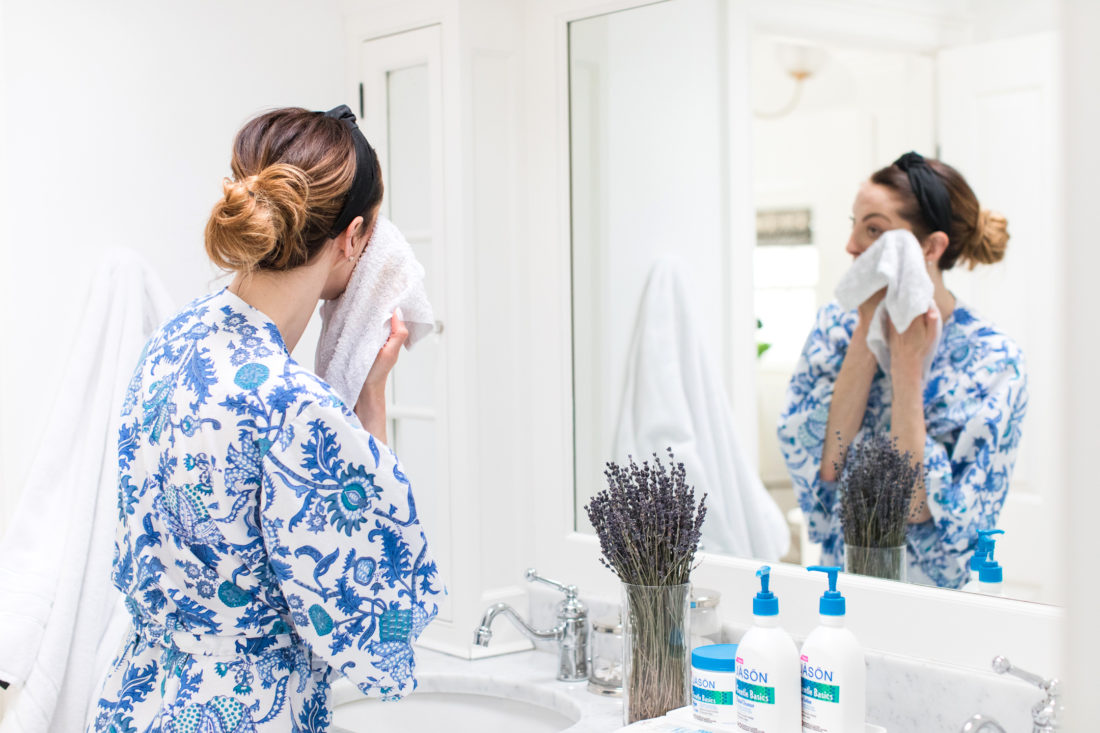 Eva Amurri Martino uses a warm washcloth to wipe away her facial cleanser