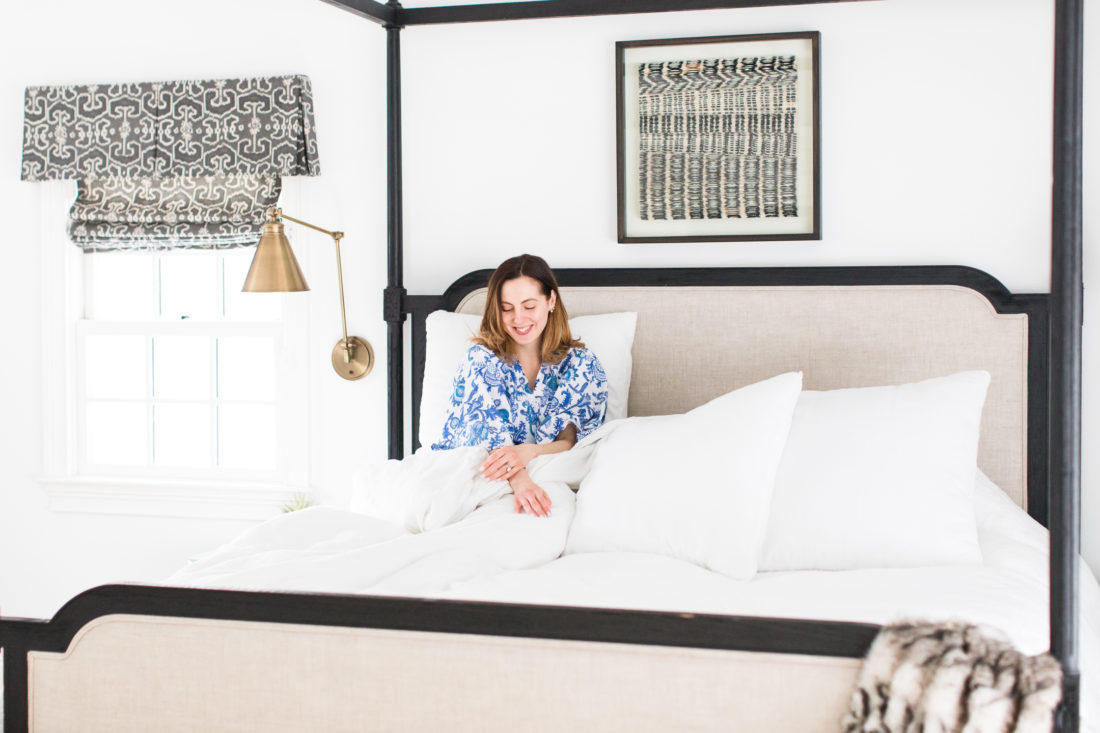 Eva Amurri Martino relaxes in bed wearing a blue and white patterned robe