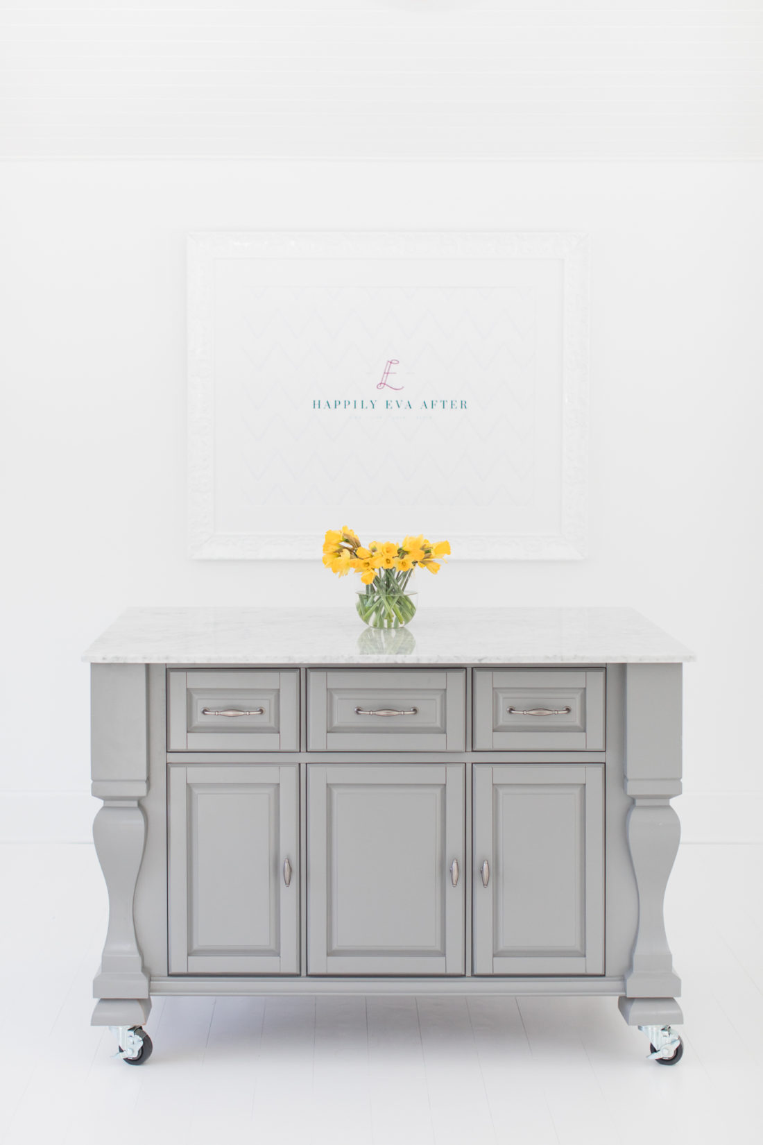 The marble topped island and framed logo in the Happily Eva After studio