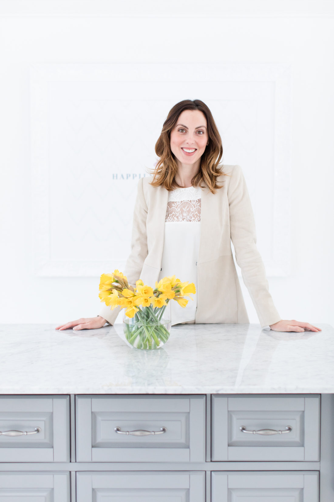 Eva Amurri Martino stands at the marble island in the center of the Happily Eva After studio space