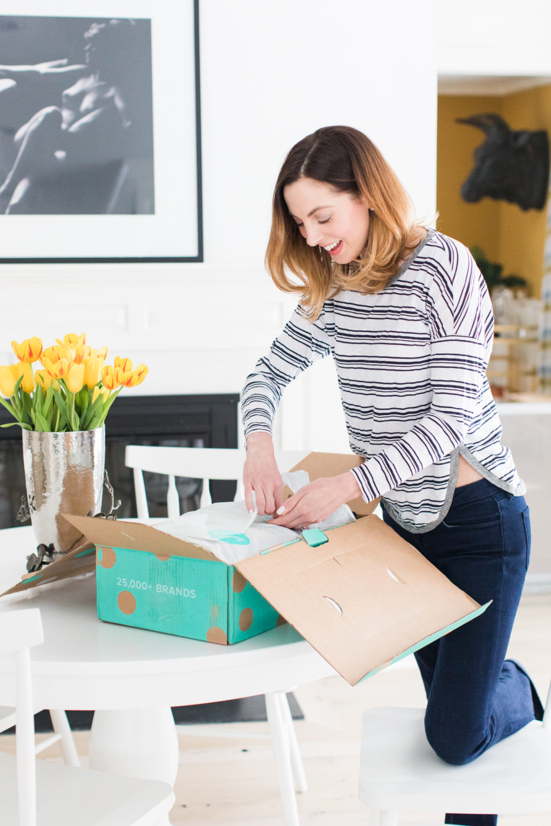 Eva Amurri Martino, of lifestyle and motherhood blog Happily Eva After, unpacks her thredUP delivery box