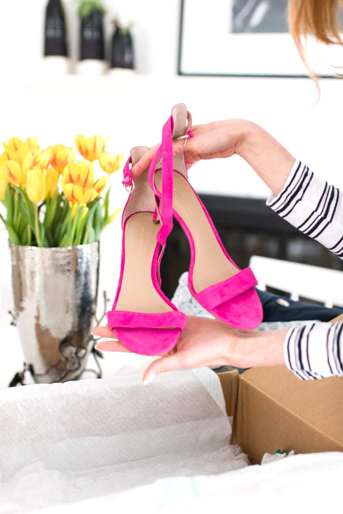 Eva Amurri Martino unpacks a pair of hot pink strappy heels from her thredUP delivery box