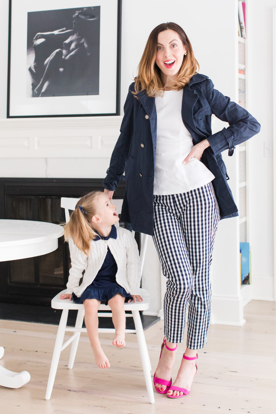 Eva Amurri Martino and Marlowe Martino wear their navy blue and white secondhand outfits from thredUP in the kitchen of their connecticut home