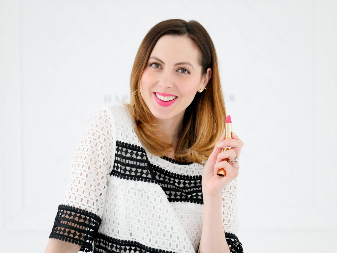Eva Amurri Martino wears a bright pink lipstick and black and white geo lace top