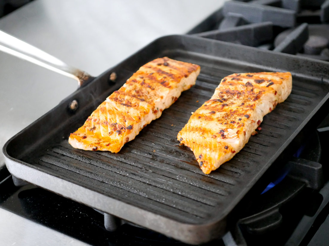 Mexican Spice-Rubbed Salmon cooks on a grill pan