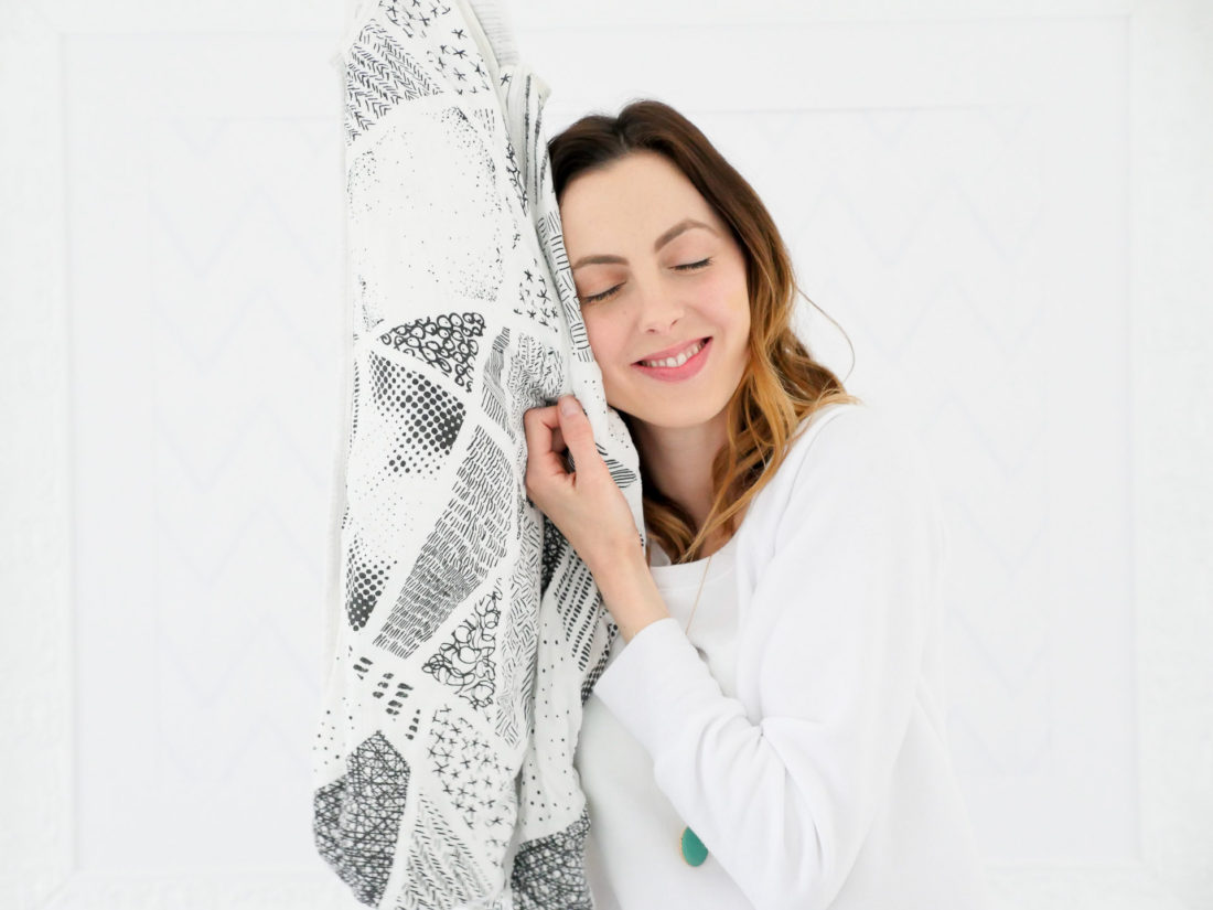 Eva Amurri Martino snuggles up to the softness of a black and white patterned sleep sack