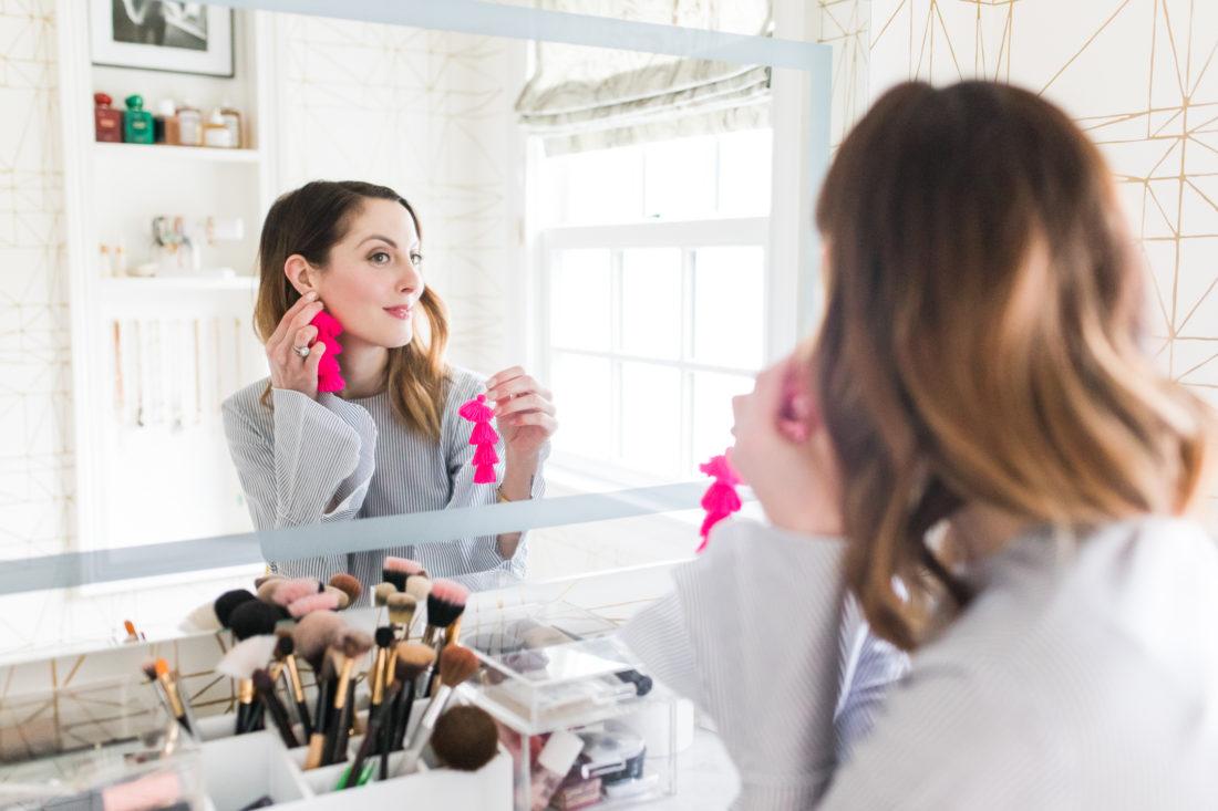 Eva Amurri Martino tries on some bright pink tassel earrings