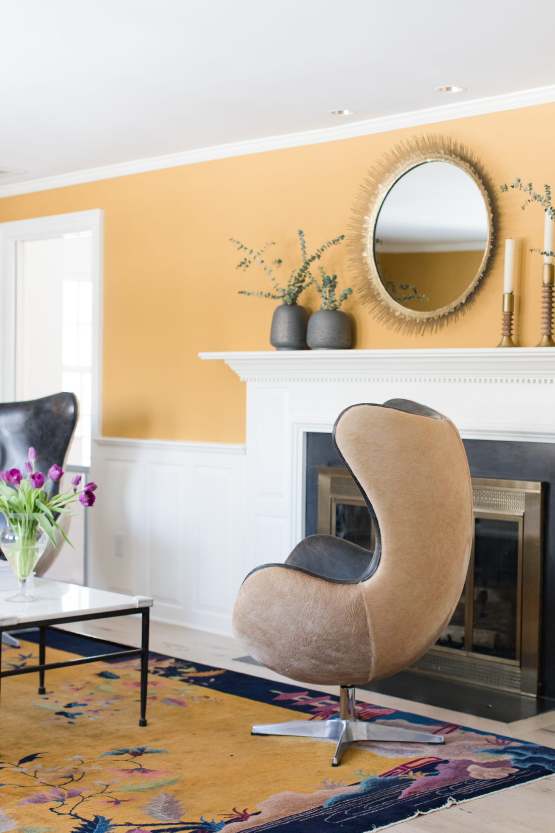 The elegant and glamorous formal living room in Eva Amurri Martino's Connecticut home, featuring a hyde-covere wingback swivel chair