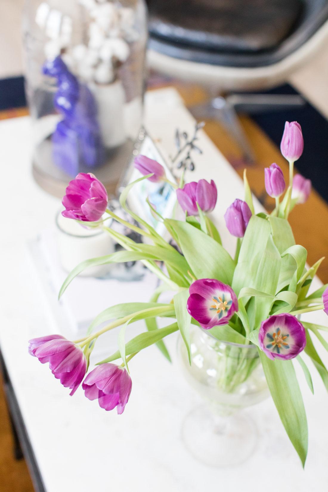 Purple tulips in full bloom on the coffee table of Eva Amurri Martino's Connecticut home