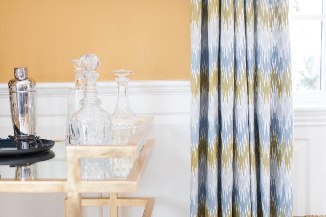 Crystal liquor decanters on the gilded bar cart in Eva Amurri Martino's formal living room