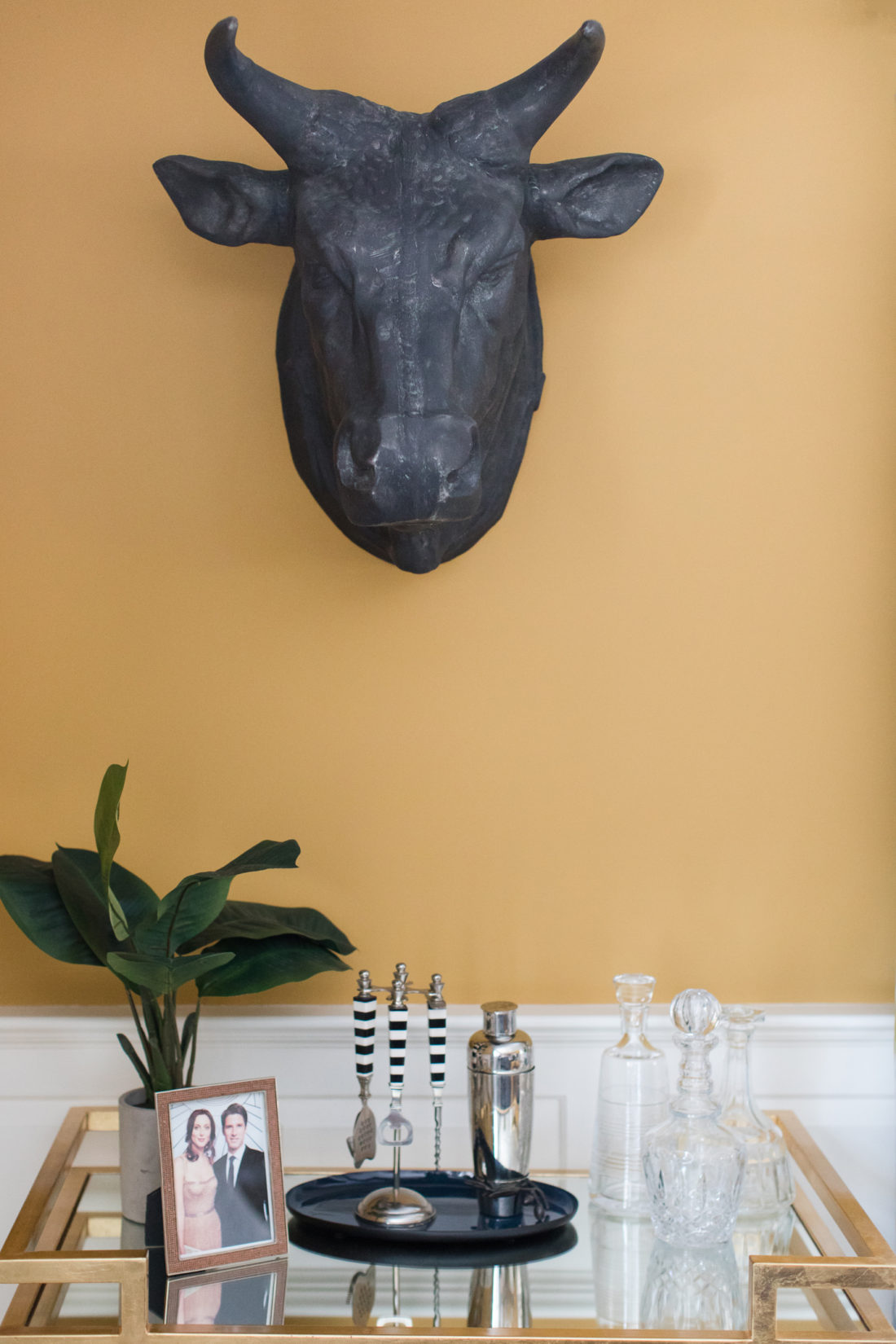 The golden deco bar cart in the formal living room of Eva Amurri martino's Connecticut home
