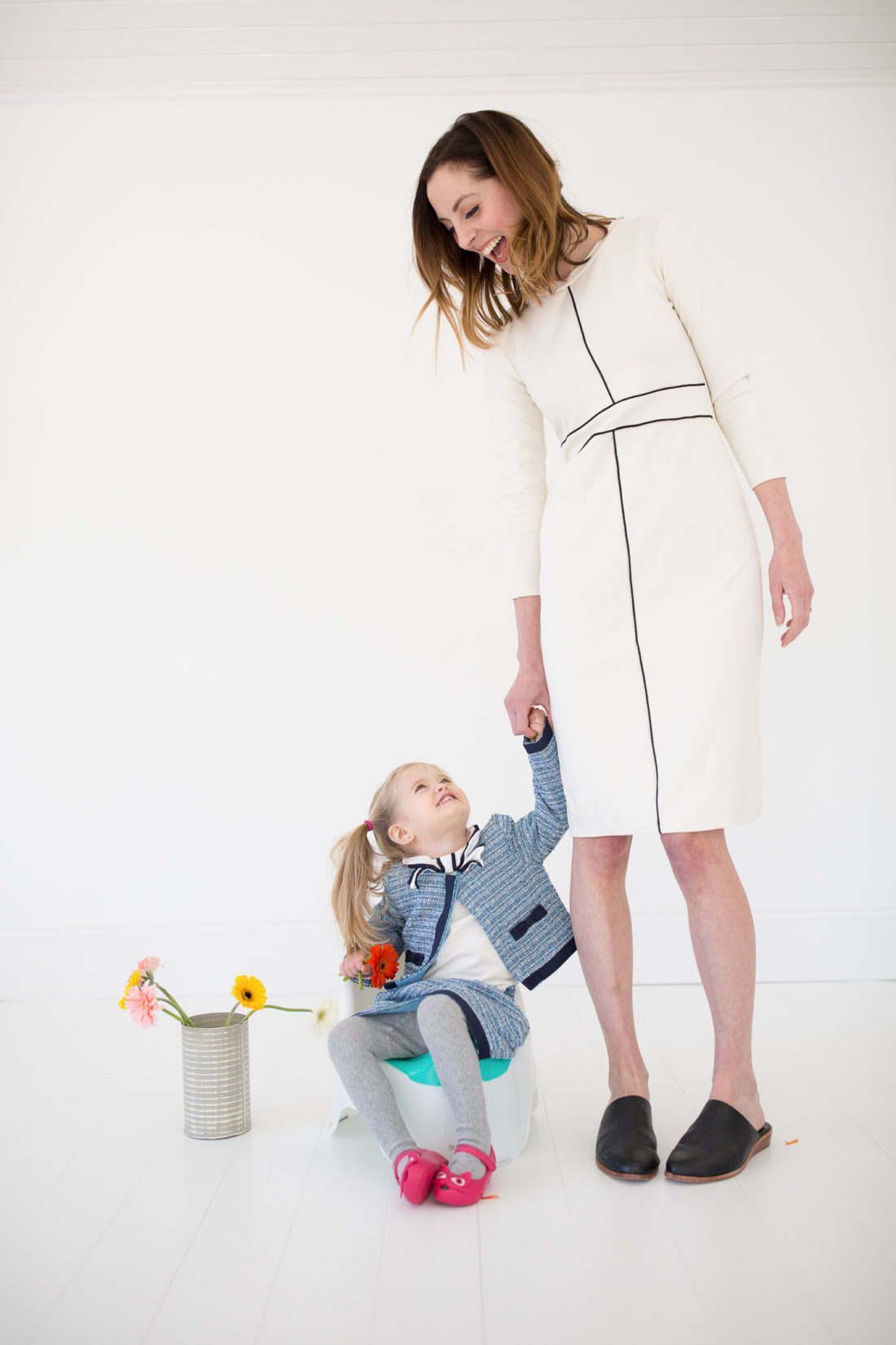 Eva Amurri Martino holds daughter Marlowe's hand while she uses the potty