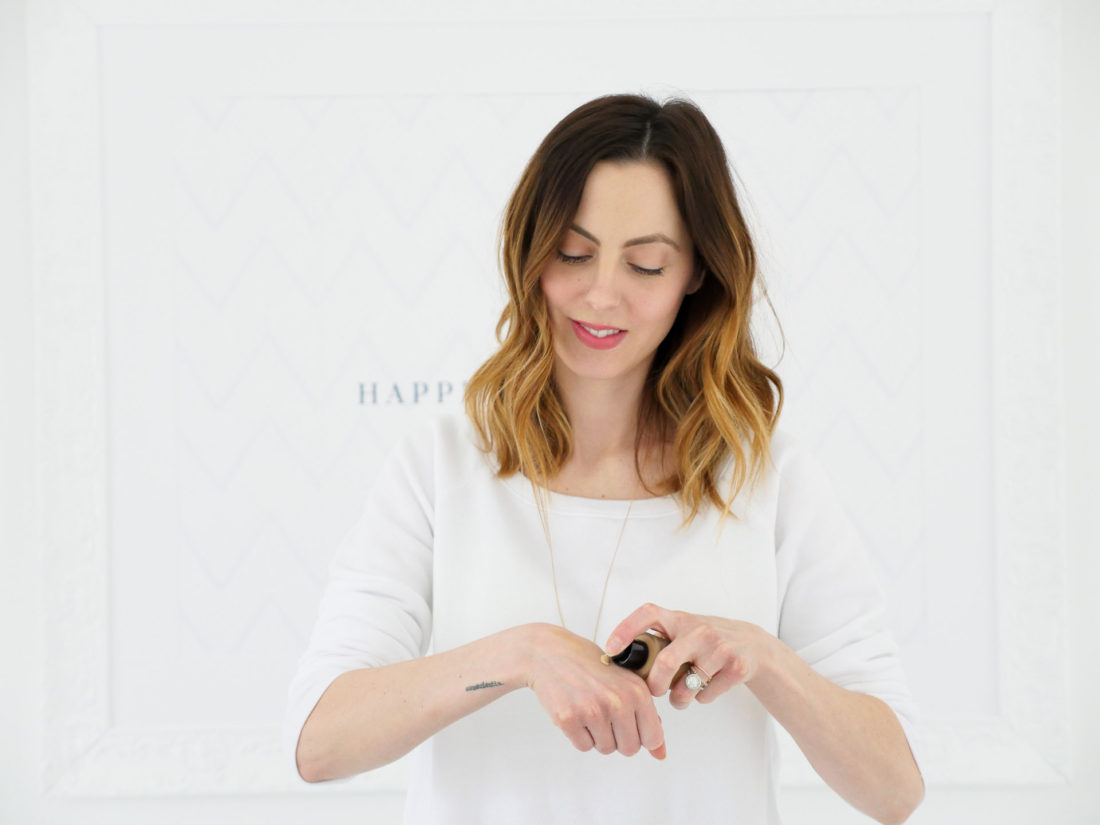 Eva Amurri Martino puts a bit of Armani Beauty foundation on her hand