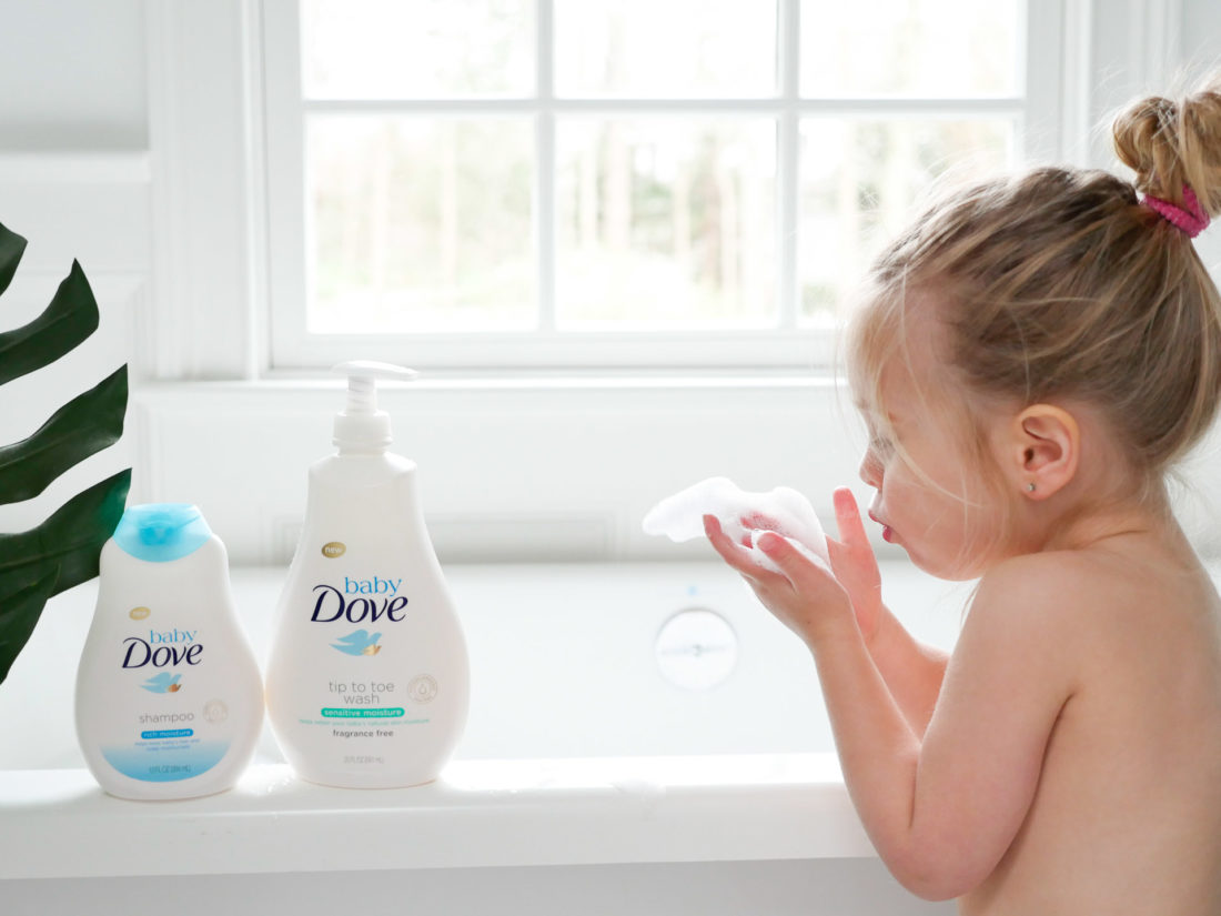 Marlowe Martino blows bath bubbles in her hands