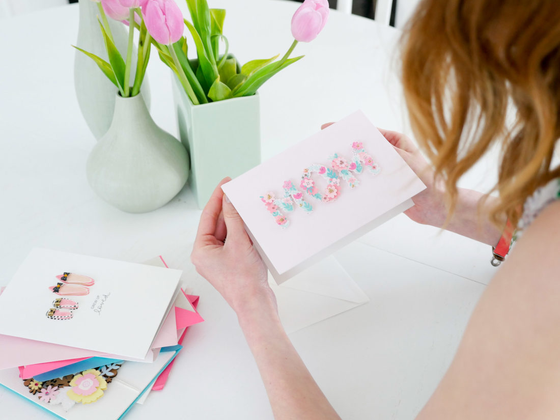 Eva Amurri Martino selects a floral, raised motif Mother's Day card to fill out for her Mother