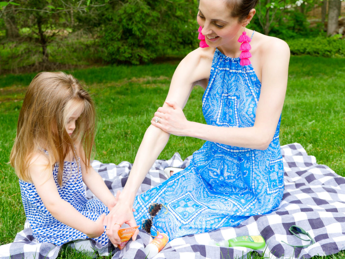Marlowe Martino helps her Mom apply sunscreen to her arms