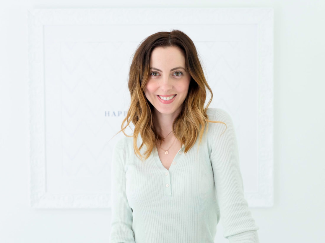 Eva Amurri Martino applies Ouai rose hair and body oil as part of her monthly obsessions