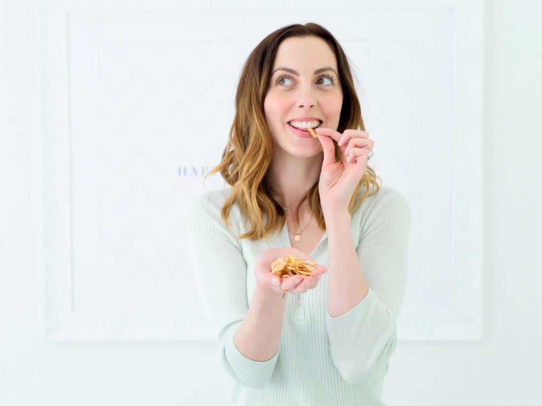 Eva Amurri Martino snacks on some Dang Coconut chips