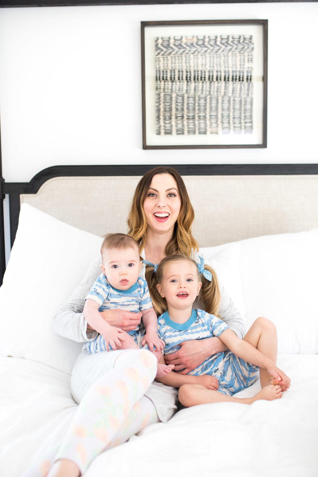 Eva Amurri Martino sits in bed with her two children wearing matching pajamas