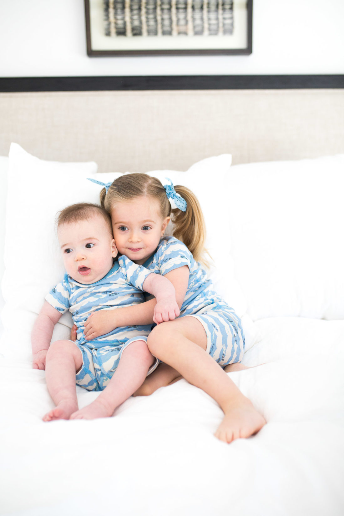 Marlowe Martino hugs her little brother Major in matching pajamas