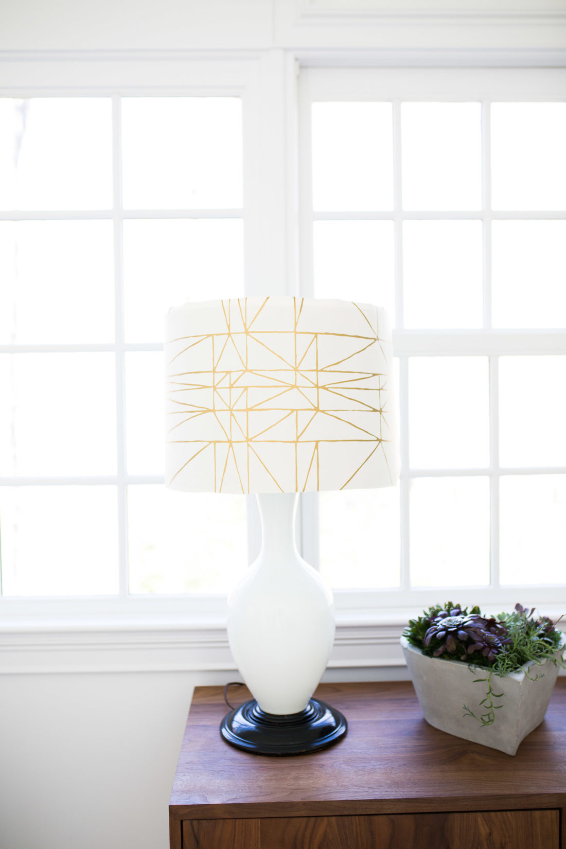 A lampshade is transformed with wallpaper