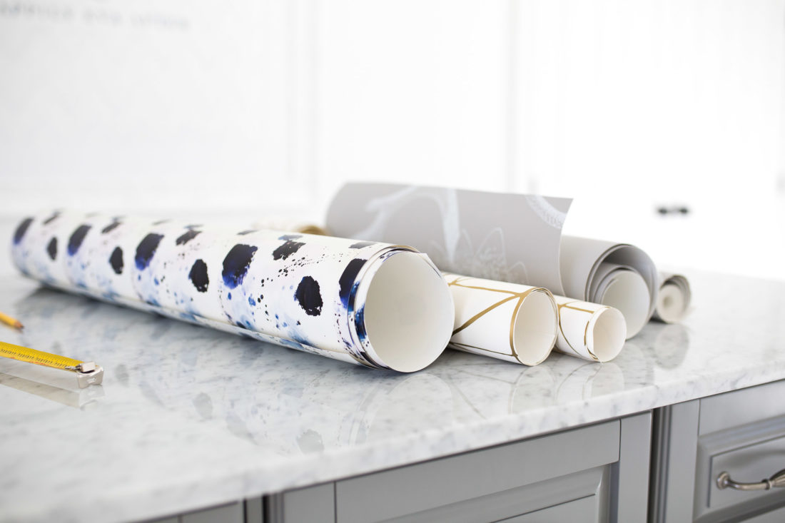 Extra rolls of wallpaper are laid out on Eva Amurri Martino's studio island.