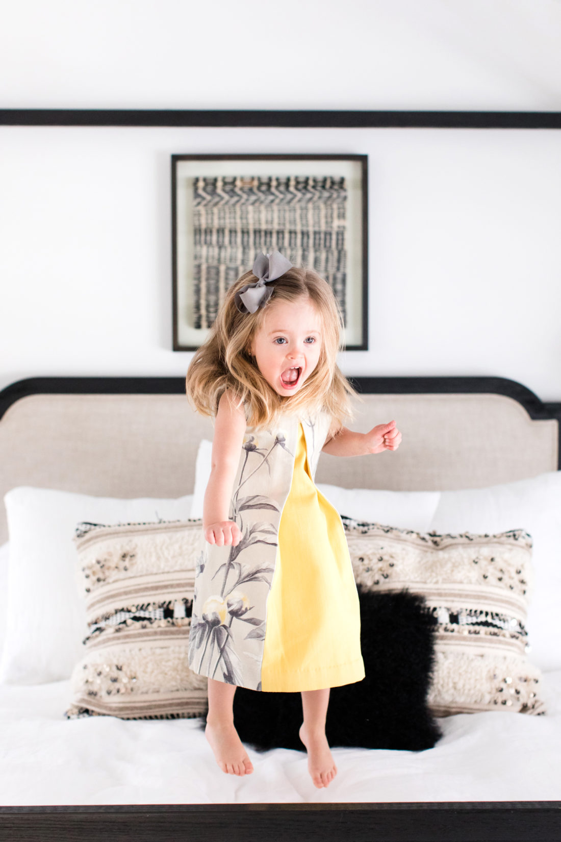 Marlowe Martino jumps happily on her mother's bed