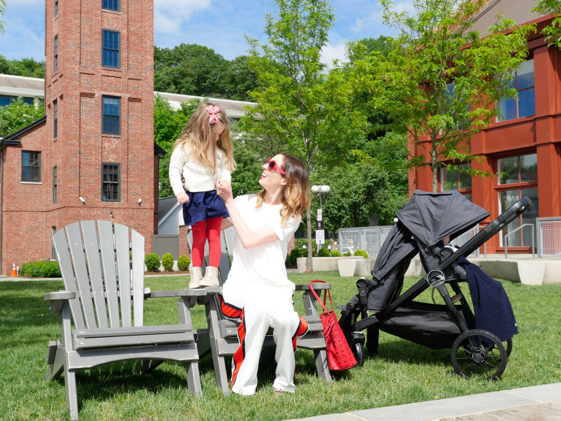 Eva Amurri Martino sits outside with daughter Marlowe and son Major in a stroller