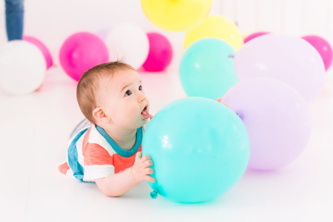 Major Martino plays with multicolored balloons for the Happily Eva After second anniversary