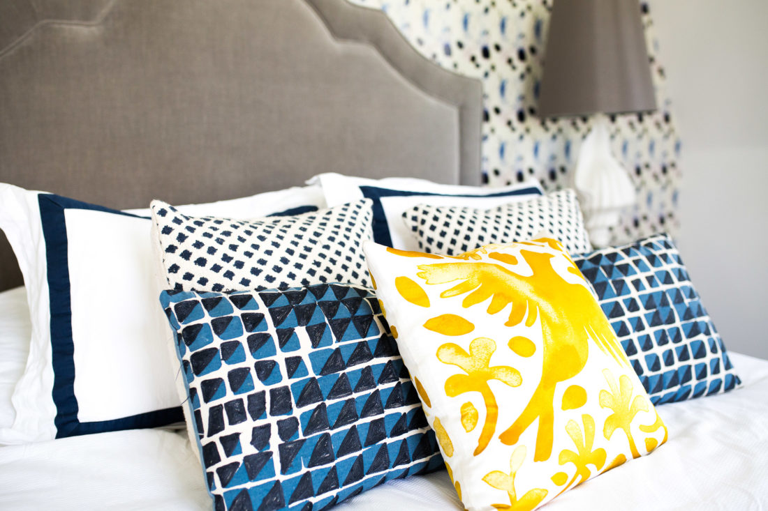 A fun mix of patterned pillows in a blue and white color scheme