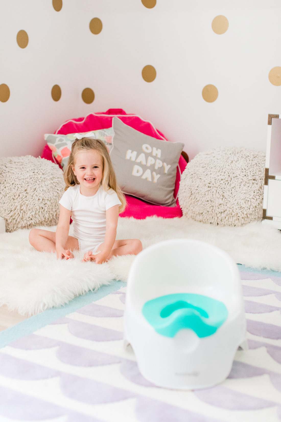 Marlowe Martino sits in her room with her potty chair