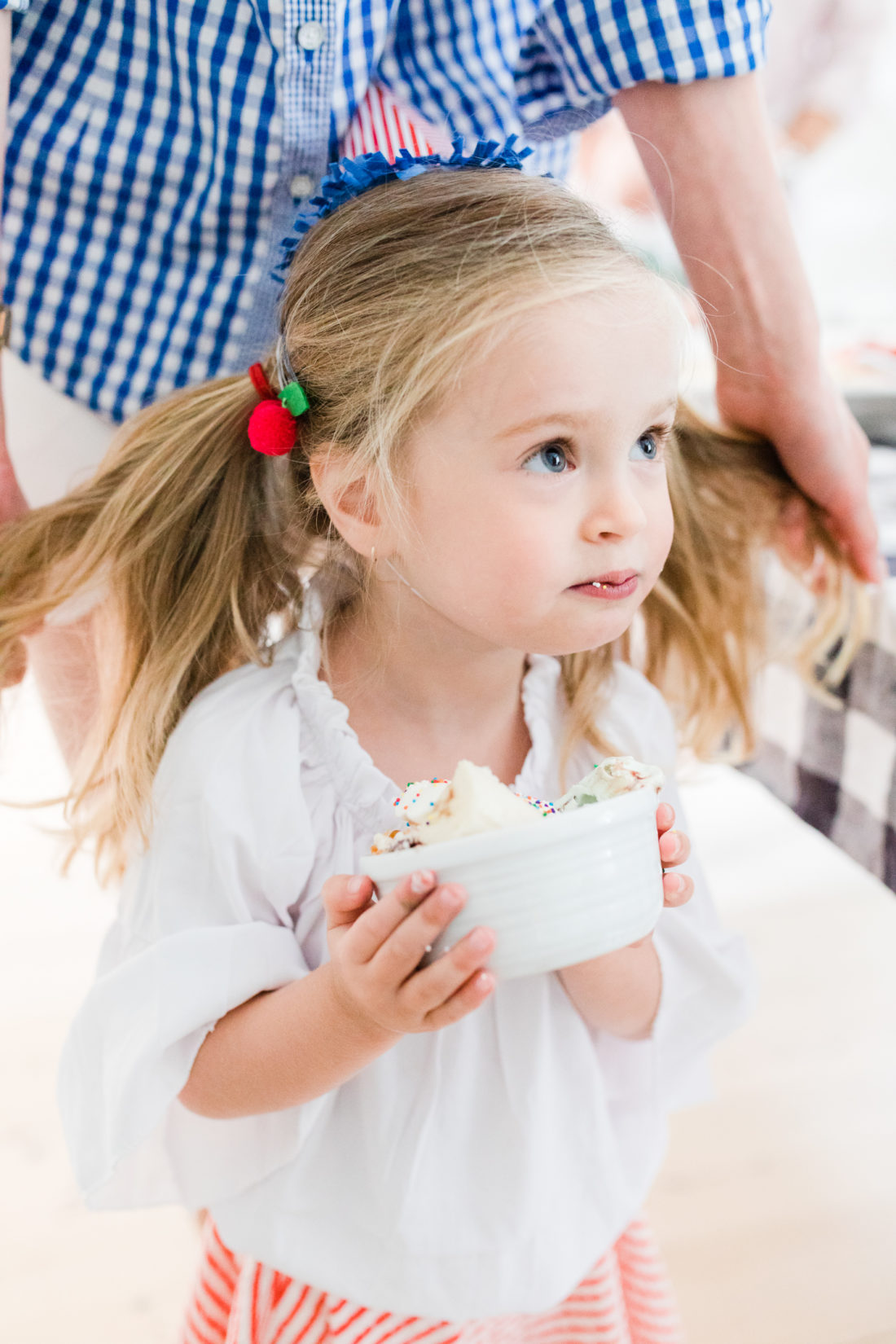 Marlowe Martino tucks in to her Blue Bunny ice cream sundae