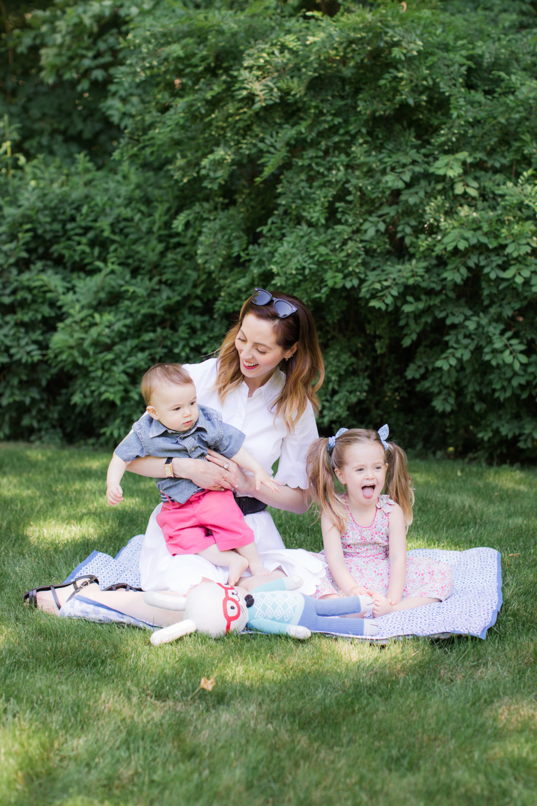 Eva Amurri Martino of lifestyle and motherhood blog Happily Eva After relaxes on a picnic blanket with her two children Marlowe and Major