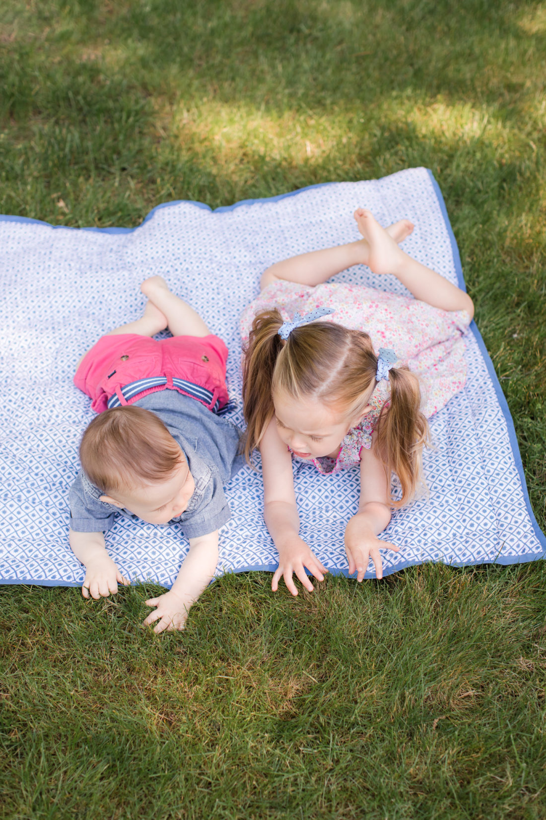 Marlowe and Major Martino lay on a picnic blanket together on the grass outside their Connecticut home