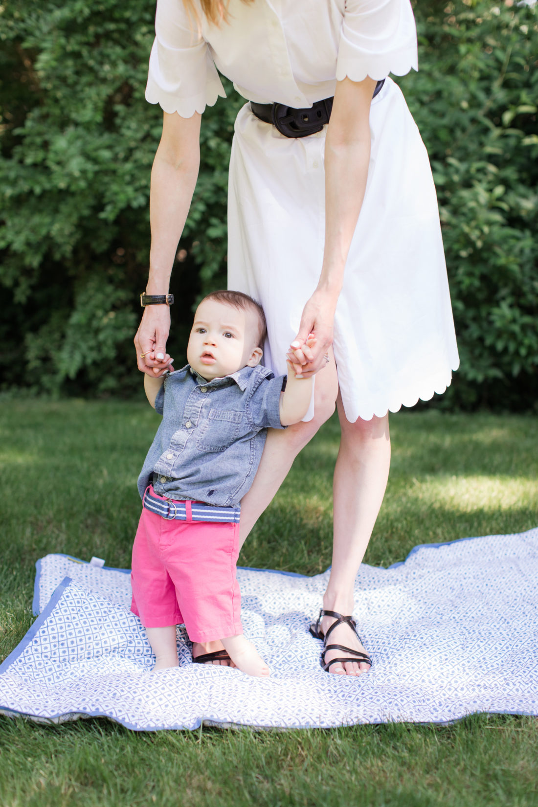 Eva Amurri Martino holds up eight month old son Major outside their connecticut home