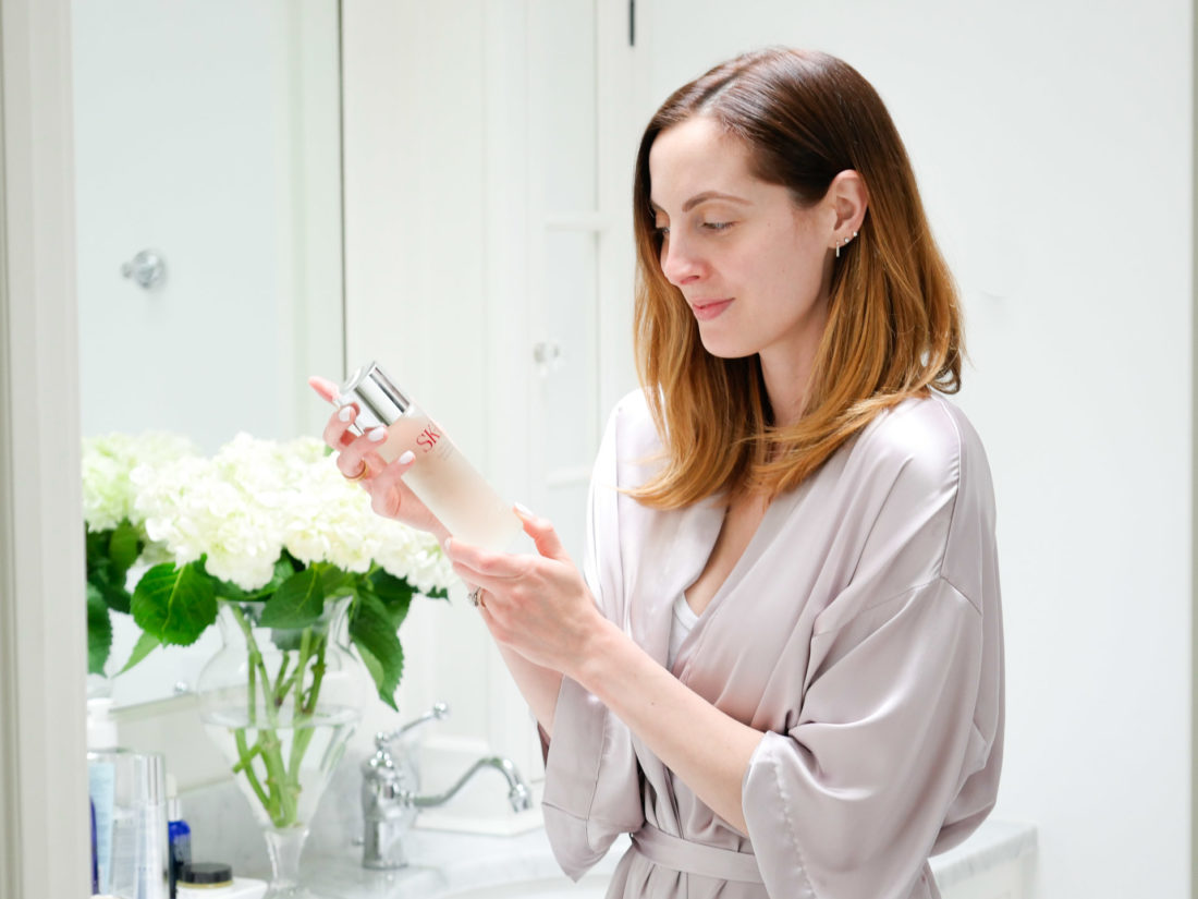 Eva Amurri Martino holds a bottle of SKII facial treatment essence in the bathroom of her Connecticut home