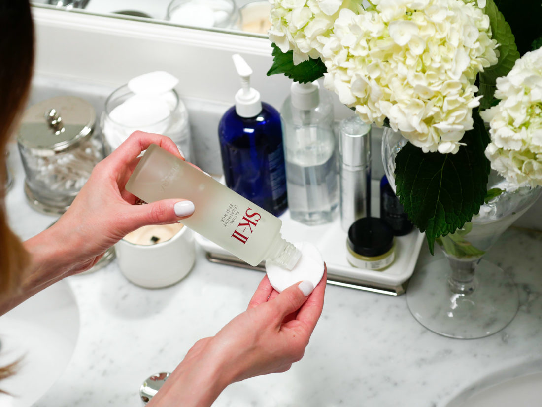 Eva Amurri Martino shakes some facial treatment essence on to a cotton pad before applying