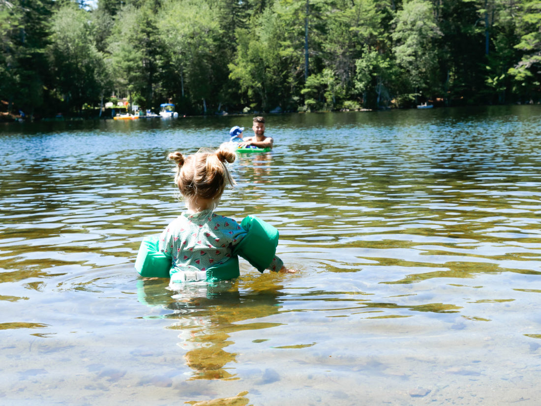 Marlowe Martino wades out in to the water in Long Pond on Mount Desert Island in Maine