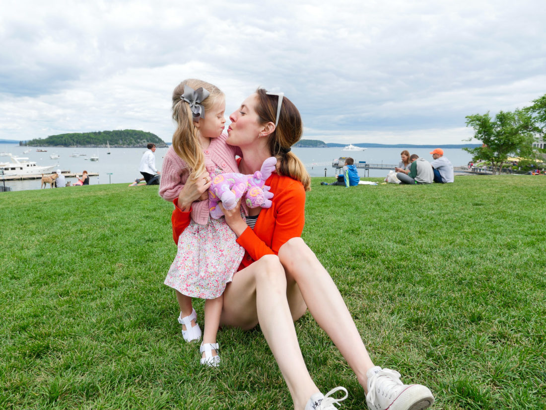 Eva Amurri Martino leans in for a kiss with two year old daughter, Marlowe, on the green in downtown Bar Harbor, ME