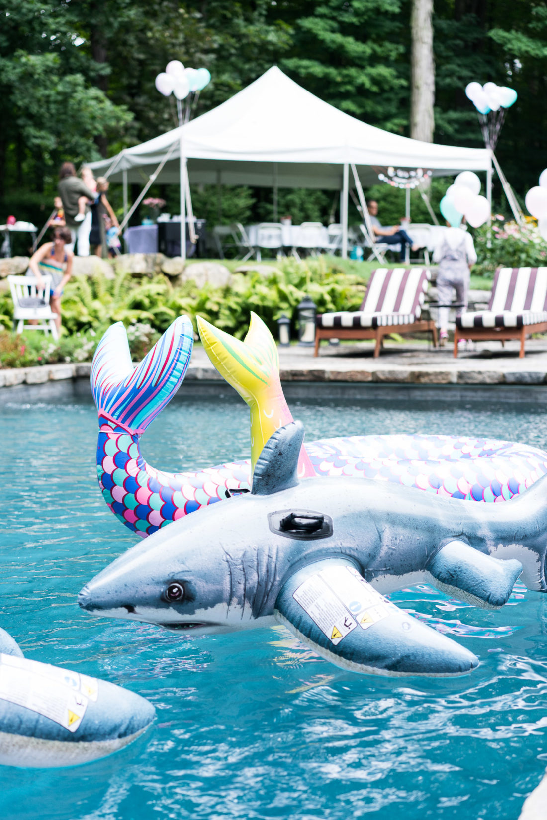 Mermaid and shark floats fill the pool at Marlowe Martino's third birthday party